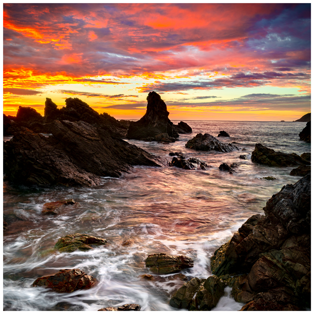 sunrise over burgess beach rocks in forster nsw