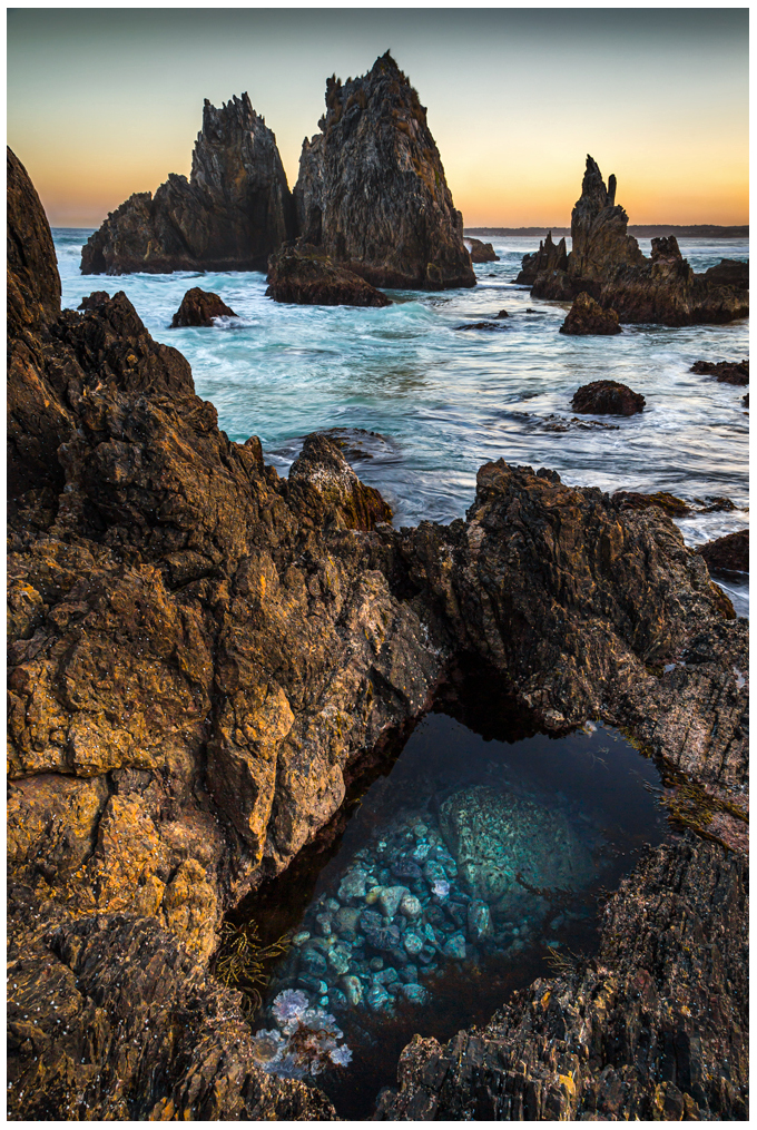 sunset over blue ocean in bermagui nsw australia