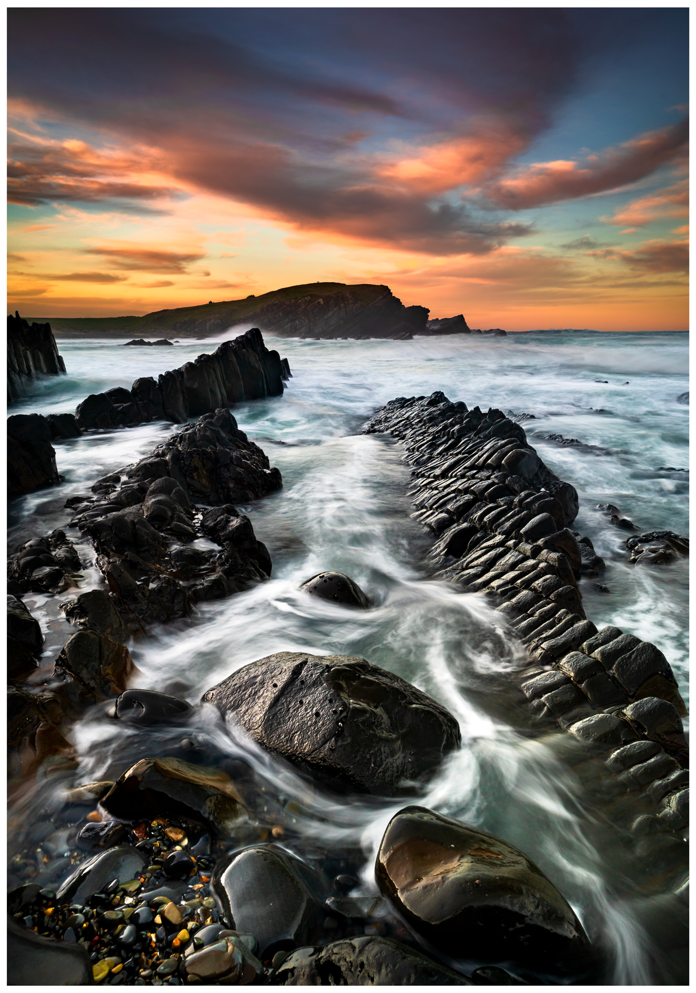 sunset over pebbly beach in crescent head nsw australia