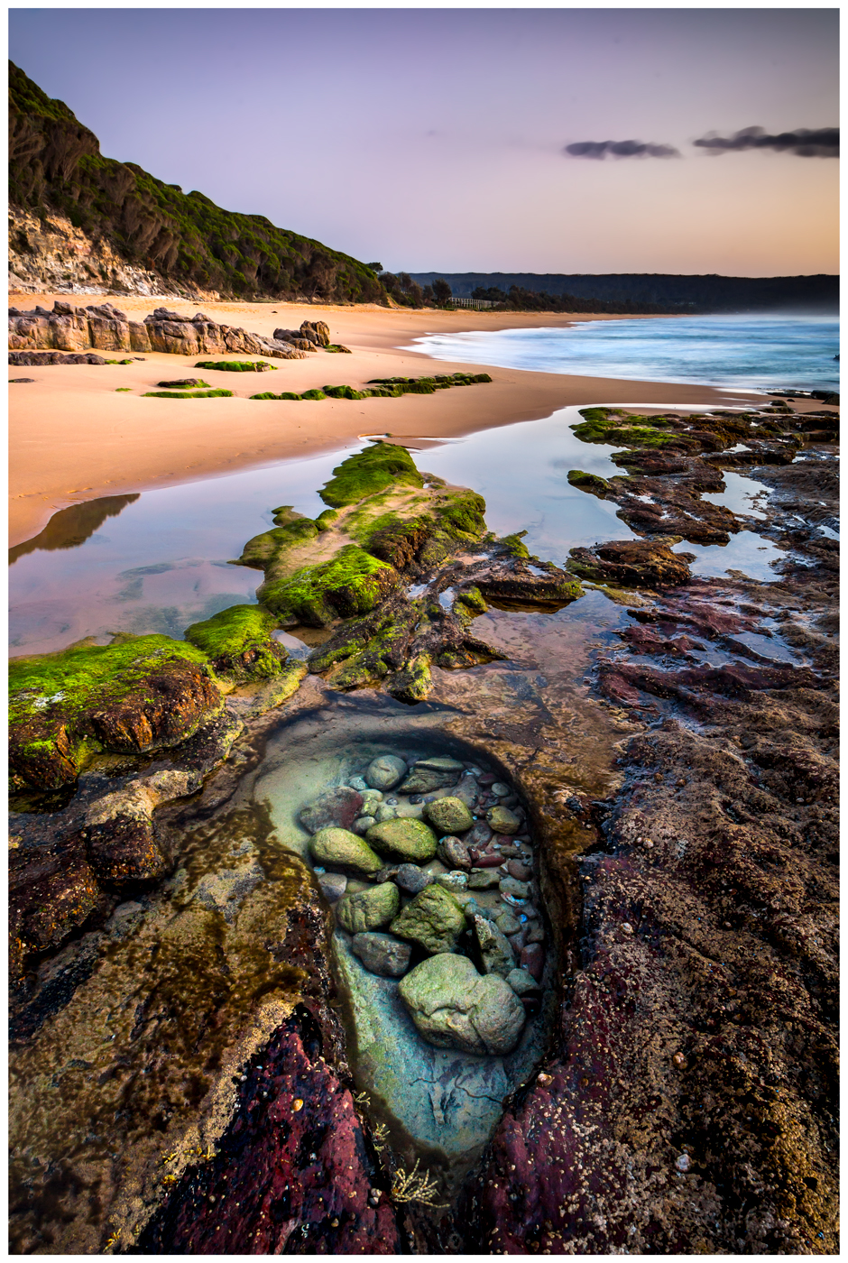 sunrise over rock pool at aislings beach in eden nsw