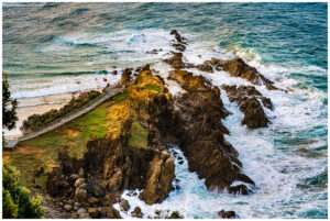 waves breaking at byron bay lighthouse in nsw